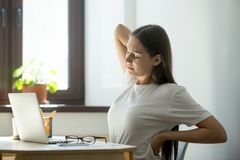 Female manager stretching her back Royalty Free Stock Images