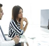 Female Manager talking to the client. Royalty Free Stock Photos