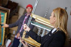 Female manager talking to worker in warehouse Royalty Free Stock Images