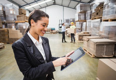 Female manager using digital tablet Royalty Free Stock Photos