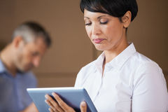 Female manager using digital tablet in warehouse Royalty Free Stock Photography