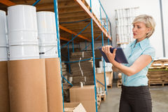 Female manager using digital tablet in warehouse Stock Photos