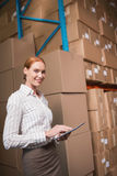 Female manager using digital tablet in warehouse Royalty Free Stock Image