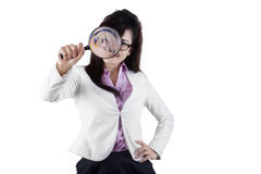 Female manager using a magnifier Royalty Free Stock Photo