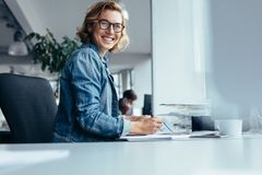 Female manager working at her desk Stock Images
