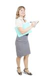 Female  manager writing on a notebook over white Stock Photography