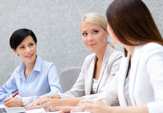 Female managers discuss business plan. Female colleagues discuss business plan sitting at the conference hall. Team achievement Stock Photography