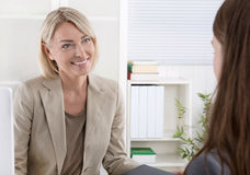 Female managing director in a job interview with a young woman. Mature businesswoman in a job interview with a young woman stock photos