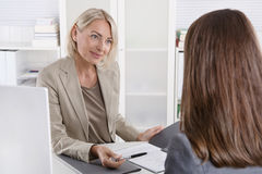 Female managing director in a job interview with a young woman. stock photo