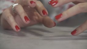 Female manicure of arm close up. Close up of woman`s fingers with red nails stock video