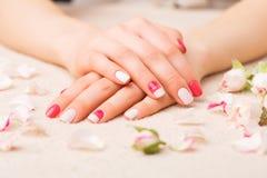 Female manicure. Pretty female manicure in beauty salon stock photography