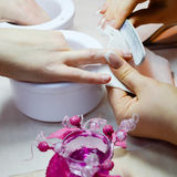 Female manicure procedure in beautician salon Royalty Free Stock Photos