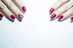 Female manicure in red tones