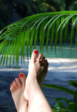 Female manicure on tropical resort Royalty Free Stock Photo