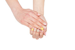 Female Manicure, women's hands on a white background Stock Images