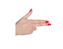 Female manicured hand pretending to shoot isolated on white Stock Image