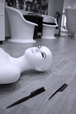 Female mannequin. On the floor, near two combs Stock Image