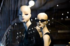Free Female Mannequin Doll Displayed N The Shop Window With City Reflections Royalty Free Stock Images - 121139319