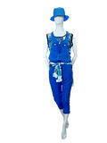 Female mannequin dressed in blue jeans overalls. Stock Photo