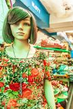 Female mannequin dressed in casual clothes in a storefront, shoes blurred backgrounds. Phsa Thmei Market, Phnom Penh City, royalty free stock photo