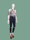 Female mannequin dressed in jeans and a checkered shirt. Stock Image