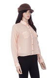 Female mannequin dressed with pink blouse and brown hat on white background Royalty Free Stock Images