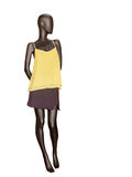 Female mannequin dressed in skirt and yellow top. Royalty Free Stock Photos