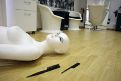 Female mannequin. On the floor, near two combs Stock Photos