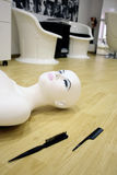 Female mannequin. On the floor, near two combs Royalty Free Stock Photos