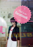 Female mannequin inside store. Facebook sign on the window. Stock Photo