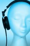 Female Mannequin listening to Music. Female mannequin head listening to music with red overlay royalty free stock image