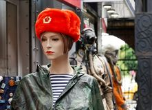 Female mannequin in a souvenir red Russian military cap royalty free stock photography