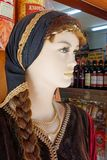 Female Mannequin in Traditional Greek Costume, Metsovo, Greece. A female mannequin wearing traditional Greek clothing or costume, including a head scarf, outside royalty free stock photography
