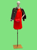Female mannequin wearing red dress and leather jacket. Royalty Free Stock Photos