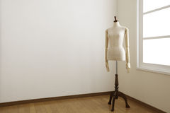 Female mannequin in white room. Royalty Free Stock Photo