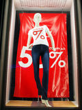 Female mannequin in the window behind the glass Royalty Free Stock Photo
