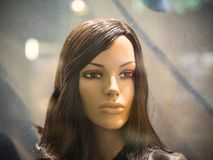 Female mannequin in the window under artificial lighting Stock Photo