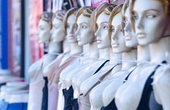 Female mannequins with cord around neck Stock Photos