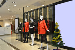 Female mannequins in fashion shop hall,clothing store,clothes store,fashion shop. Interior view of a fashion shop hall,Hongkong,China,Asia. Red and black dress Royalty Free Stock Photo