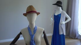 Female mannequins fitting on stylish clothing, accessories and apparels standing in showroom or shop.