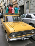 Female mannequins on the retro car Moskvich in Lviv Stock Photos