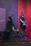 Female mannequins in a shop window and reflected lights Stock Photo