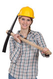 Female manual worker with axe Stock Photo