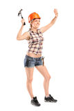 Female manual worker with hammer Royalty Free Stock Photos