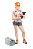 Female manual worker holding a clipboard Stock Photography
