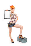Female manual worker holding a clipboard Royalty Free Stock Photo