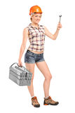 Female manual worker holding a tool royalty free stock photo