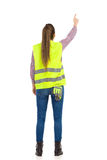 Female Manual Worker Pointing Rear View Royalty Free Stock Image