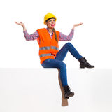 Female Manual Worker Sitting On A Banner Royalty Free Stock Photography