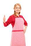 A female manual worker wearing an apron and giving thumb up Royalty Free Stock Photo